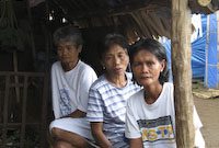New guidelines from the IASC aim to improve the psychosocial support that humanitarian agencies extend to survivors of conflicts and natural disasters, like these women from Albay, Philippines, who lost loved ones and homes to Typhoon Durian. © IOM 2007 (Photo: Mia Goloy)