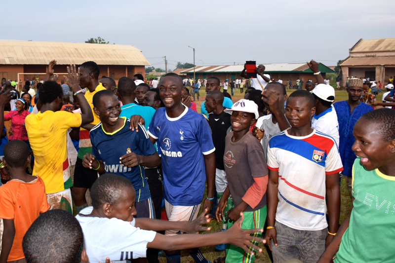 Members of the community celebrated after the end of the match, which was won 1-0 by the local team Beau Sejour. Beau Sejour is the team of the Association of Young Muslims, one of the groups that planned the event by inviting people from all over the district, religious groups, and African Union and French forces, among others. © IOM 2014 (Photo by Sandra Black)