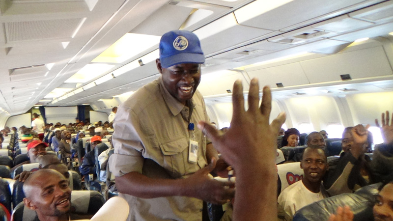 IOM helped 314 Chadians leave the Central African Republic (CAR) and flew them back to Chad. This was the 19th evacuation flight conducted by IOM for Third Country Nationals (TCNs) exiting CAR. © IOM 2014 (Photo by Sandra Black)