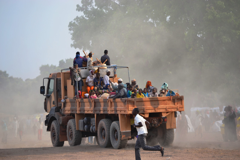 Chadian military convoy arriving in Doyaba Transit Centre, Sarh with 2,000 returnees. © IOM 2014 (Photo by Craig Murphy)
