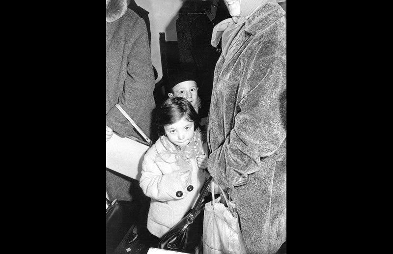 Hungarian refugees wait to board an ICEM train. Photo © IOM 1957 – HYU0009