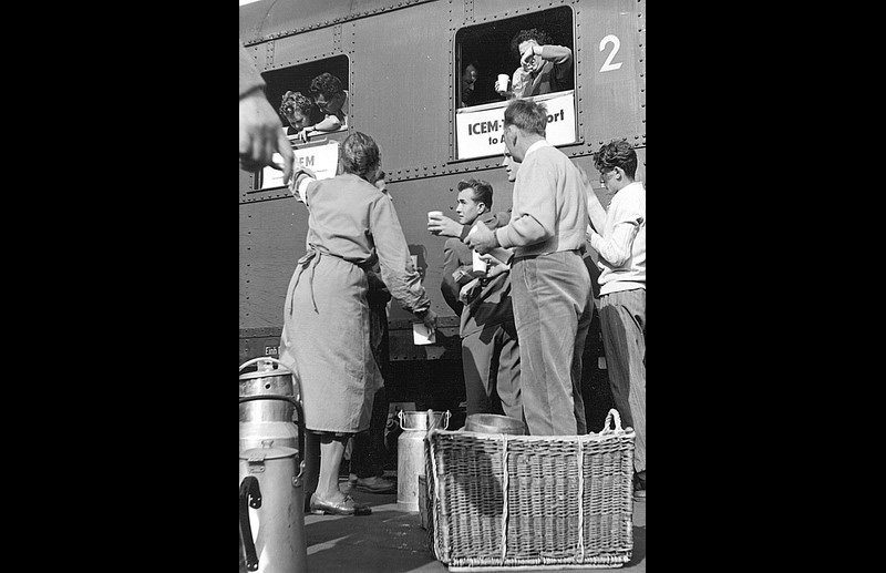 Red Cross volunteers hand out hot tea and coffee to refugees aboard an ICEM chartered train, carrying TB patients to be resettled in Sweden. Photo © IOM 1957 – HAT0035