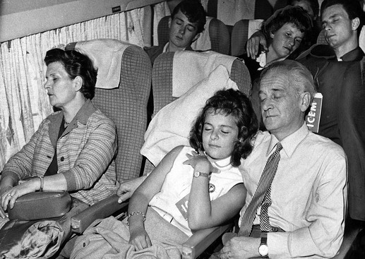 The Major family, refugees from Hungary, rest peacefully aboard a plane heading for Washington D.C. From left Ida, the mother; Marianne, thirteen; Sandor the father; rear, Sandor, eighteen, who was a freedom fighter at sixteen, and two friends. Photo © Kay Brennan 1959 – HUS0019