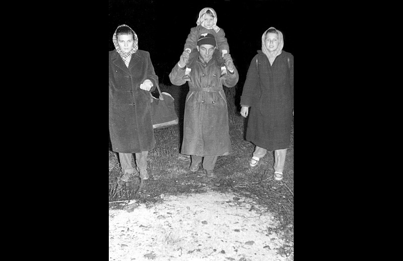 A Hungarian family flees to Austria over the Andau Border Photo © IOM 1956 – HAT0278