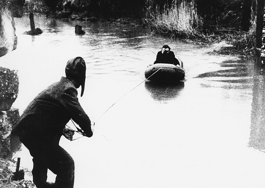 It is something only a short but dangerous journey to freedom. An Austrian assists a Hungarian escape cross into Austria. Photo © IOM 1956 – HAT0347