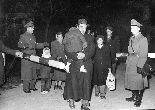 Safe at last Hungarian families relax as they cross the border into Austria. Photo © IOM 1956 – HAT0295
