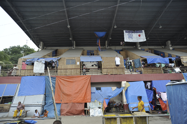Shortly after the conflict, IOM built bunkhouses and individual units inside the stadium.  IOM staff currently manage the site along with the Department of Social Welfare and Development (DSWD).  Activities also focus on protection, health and sanitation and communicating important messages about the humanitarian response to the displaced population.  © IOM 2014 (Photo by Alan Motus)
