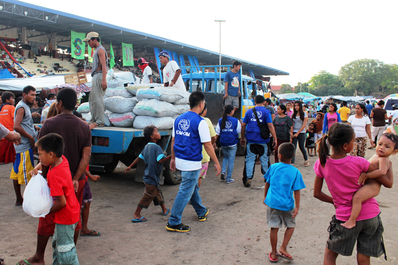 """IOM staff inside the Joaquin F Enriquez Memorial (""""Grandstand"""") Stadium in Zamboanga city, where some 21,000 people are still displaced. © IOM 2013 (Photo by Joe Lowry)"""
