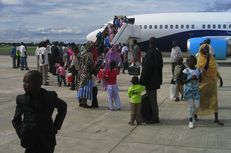 IOM staff receives returnees from Kosti, Sudan at Juba airport. A total of 1,890 South Sudanese have arrived in the South Sudan capital as IOM plans to increase the number of flights to six per day to complete the movement in the next few weeks. © IOM 2012 (Photo by Lana Oh)