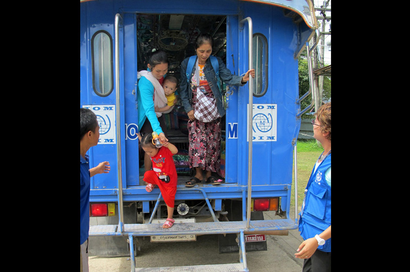 Ma Lay Lay (24), her children Labur Paw (3) and Ywar Mar Ser (11 months) arrive at the IOM refugee processing centre in Mae Sot, northern Thailand. © IOM 2012