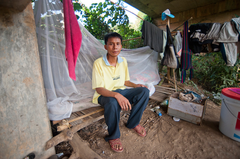 Under the Bridge: Myanmar migrant Doy Sen outside his home for the past three years. © Mikel Flamm 2013