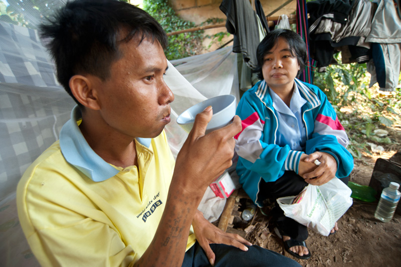 To beat TB, patients must take a full course of drugs every day for at least six months. Here, Nurse Sriweing Suthigenda watches Doy Sen take his medication. © Mikel Flamm 2013
