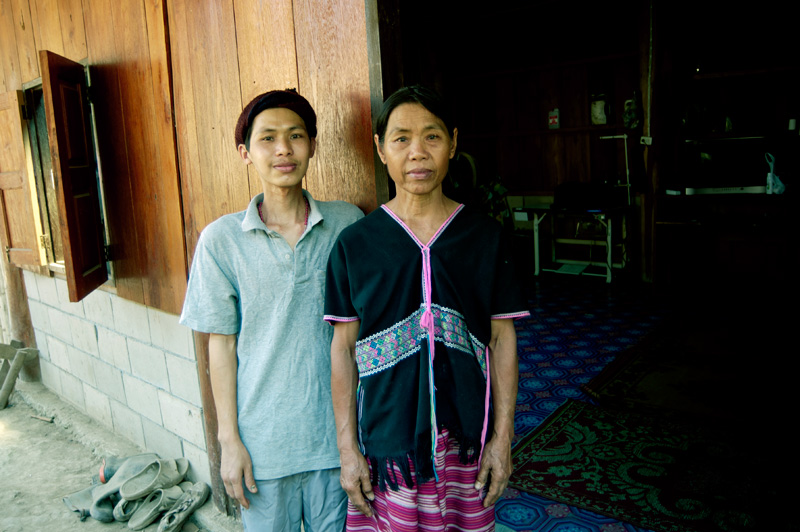 Wirasat Kornapa, 33, who suffers from cancer and TB, and his mother, O, who has high blood pressure outside their house in the remote village of Ban Huay San.  © Mikel Flamm 2013