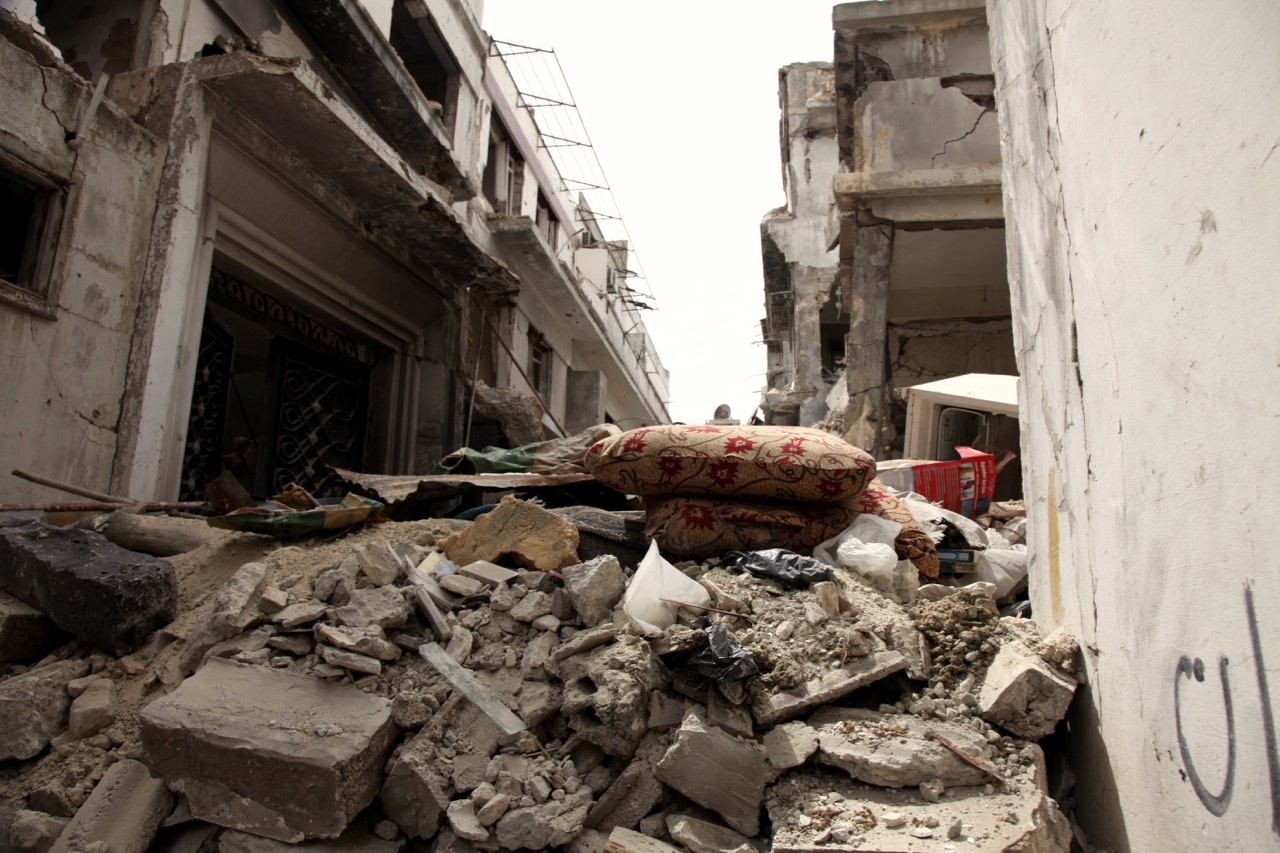Debris blocks one of the streets in Homs. It is estimated that 1 Million Tons of debris need to be removed from Homs. Photo: IOM/Batoul Ibrahim 2016