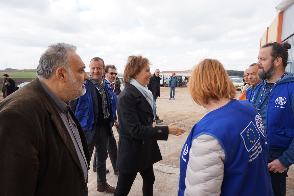 IOM's Deputy Director General Laura Thompson visited the migrants' accommodation site in Thiva, accompanied by the Minister of Migration Policy, Ioannis Mouzalas and IOM's Chief of Mission in Greece, Daniel Esdras. The new accommodation site in Thiva will welcome 700 refugee and migrants by the end of March. Photo: IOM