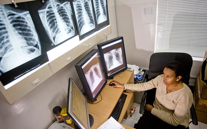 A radiologist examines x-rays on a digital system. Part of IOM's resettlement programme is to provide medical screening, cultural orientation and travel arrangements of refugees accepted for resettlement. © IOM/Kari Collins 2009 - MNP0119