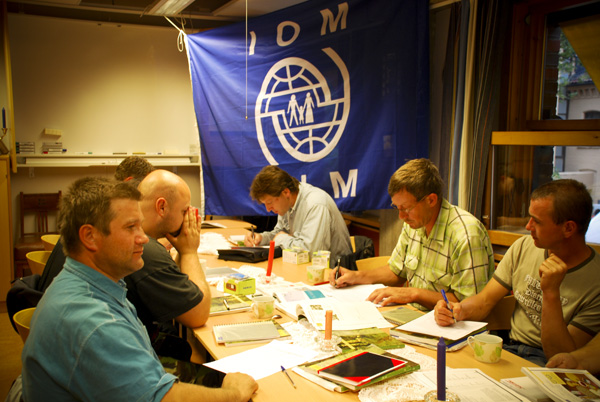 A group of Polish construction workers in Norway participates in a language training class as part of the objectives of the IOM project. © IOM 2008