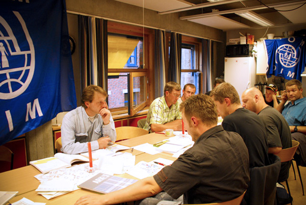 Eager to learn. Polish construction workers in Norway participate in language training classes as part of the IOM project to empower Polish migrant workers. © IOM 2008