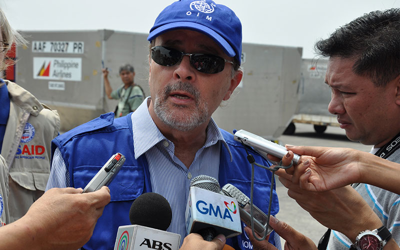IOM Regional Representative for East Asia Charles Harns answers questions from the media. IOM took delivery of a US$350,000 shipment of desperately needed water containers, hygiene kits and soap donated by USAID's Office of Foreign Disaster Assistance (OFDA) for victims of the two typhoons that have struck the northern Philippines in the past three weeks. © IOM 2009 (Photo: Vincent Houver)