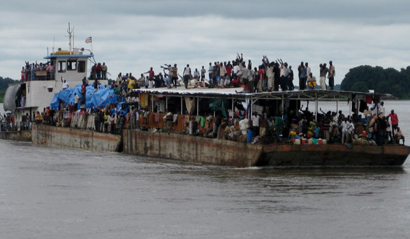 A barge carrying returnees from Kosti arrives at Juba Port. IOM provides onward transportation assistance to vulnerable and stranded returnees to return to South Sudan. In the first year of Independence of South Sudan, IOM provided OTA to 48,967 returnees, 10,964 travelled by barge. IOM organizes movements by plane, by road, by train, and by barge. © IOM 2011