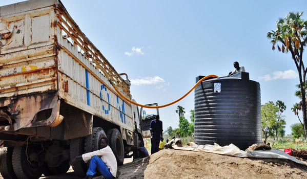 IOM trucks water to outlying villages in Doro Refugee Camp where there are over 42,000 refugees. IOM has distributed over 400 water filters to families in these areas as water trucking becomes difficult after heavy rains. IOM is drilling four boreholes to ensure that refugees in outlying areas will not be dependent on water trucking through the rainy season. © IOM 2012