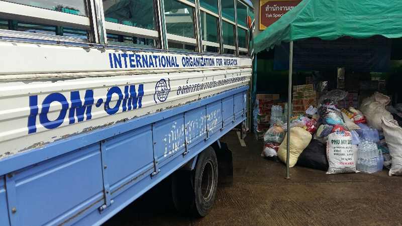 Relief items donated by the Thai Government trucked in from Mae Sot, Thailand being offloaded in Myawaddy (5 Aug). © IOM 2015