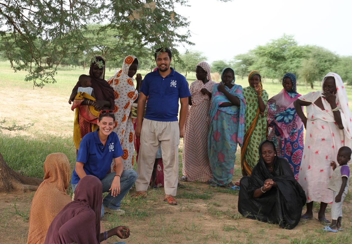 IOM staff and women from the Sissakou integrated farm, one of the villages assisted by IOM's Community Stabilisation projects in southeast Mauritania. Photo: IOM/F.Giordani