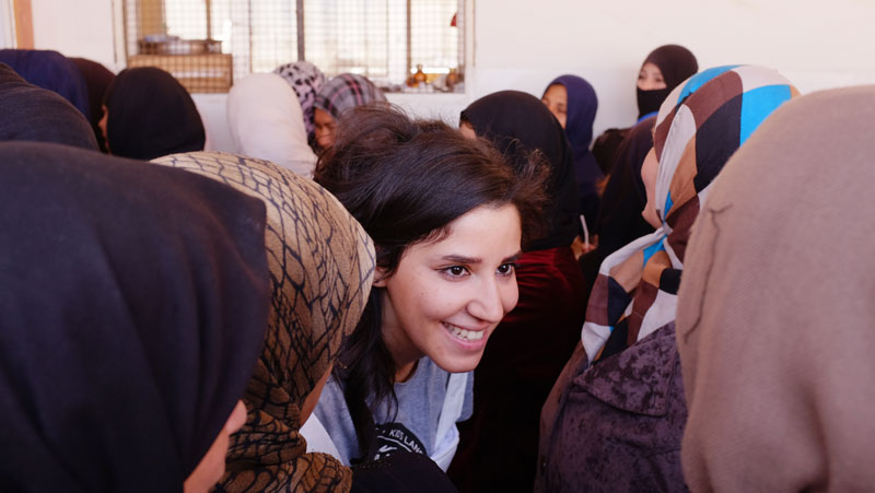 Volunteer working with IOM to support Syrians displaced by violence at a centre in rural Damascus. There has been fierce fighting in this region, particularly in hard to reach and besieged areas, including Madaya and Duma. Photo: IOM/Leonard Doyle 2016