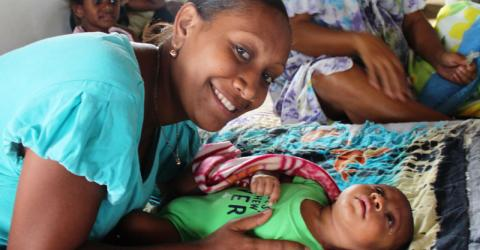 Becky Kolotrip and her two-month-old son Sammy at the Ponga Assemblies of God Church on the edge of the Vanuatuan capital Port Vila, which is currently being used as an evacuation centre. © IOM/Joe Lowry 2015