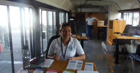 "IOM and the government of Costa Rica roll out the ""Migramóvil"", a fully equipped bus manned by migration officials who are bringing information on migration-related requirements, forms and other basic services to the Costa Rica-Panama border region. © IOM 2014"