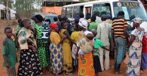 IOM provides emergency transport assistance to Rwandan returnees from Tanzania. The returnees were expelled from Tanzania following a July 2013 presidential directive requiring all undocumented migrants in the country's Kagera region to leave by 11th August 2013 or be forcibly removed by the security forces. © IOM 2014
