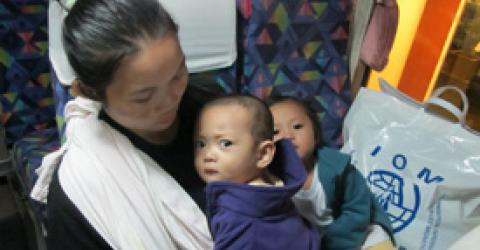 IOM in Thailand assists Ma Lay Lay, 24 and her two children, Labur Paw (3) and Ywar Mar Ser (11 months) to resettle to the USA. Her departure marked the 100,000th refugee that IOM assisted since large-scale refugee resettlement from Thailand restarted in 2004. © IOM 2012