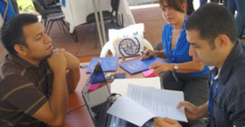 IOM staff conducts initial interviews in El Salvador and Honduras for the IOM-managed labour migration programme with Maple Leaf Foods in Canada. © IOM 2012
