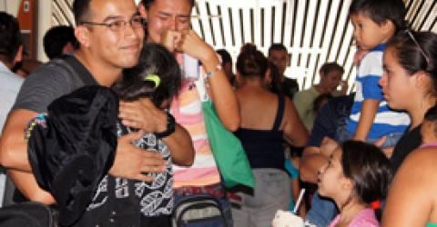 Thirty-two year old Mauro Ruano from El Salvador hugs his mother at the airport as migrant workers leave for jobs in Canada. A first group of 57 migrants from El Salvador and Honduras, selected by IOM and Maple Leaf Foods of Canada for work in the company's food processing plants, left their home countries to begin their two year contracts. © IOM 2012