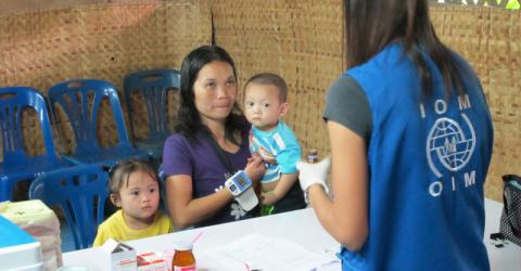 IOM organizes pre-departure screening for refugees being resettled from the camps on the Thailand-Myanmar border. Here Ma Lay Lay (24) and her children Labur Paw (3) and Ywar Mar Ser (11 months) are screened by an IOM nurse. © IOM 2012