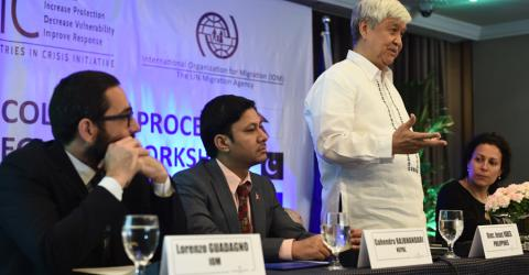 Jesus I. Yabes Undersecretary for Migrant Workers' Affairs, Department of Foreign Affairs (Philippines) speaking at a Colombo Process Meeting on MICIC in Manila. Pictured with him is Gahendra Rajbhandari of Nepal, as well as representatives of IOM. Photo: IOM