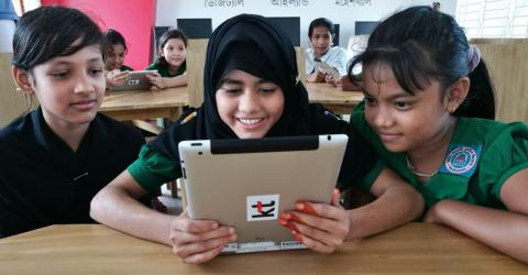 Children at a Moheshkhali school are introduced to e-learning. Photo: UN Migration Agency (IOM)/Peppi Siddiq