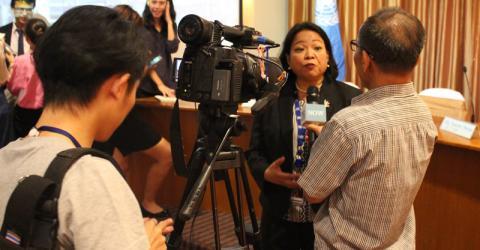 Thai TV interviews Dr. Nenette Motus at the report launch. Photo: IOM.
