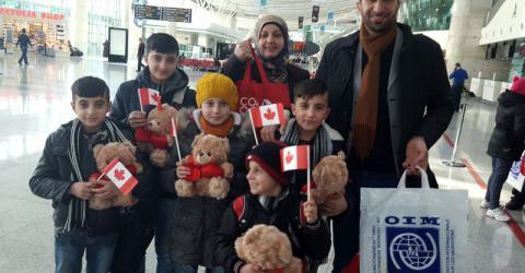 Syrian refugees at Ankara's Esenboğa International Airport prepare to leave for Toronto. Photo: IOM