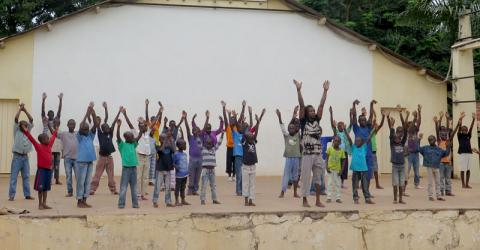 Children from different communities dance at an EU-funded workshop in Bangui. © IOM 2015