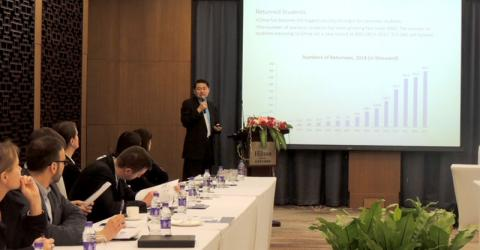 Dr. Henry Wan, President and Founder of the Centre for China and Globalization (CCG), briefs EU consular staff in Beijing on the Chinese Green Card reforms. Photo: IOM