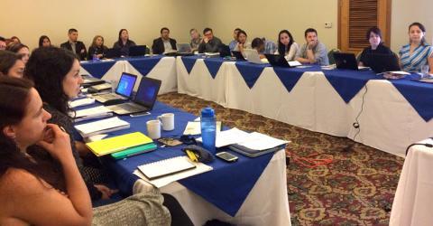 Delegates discuss protection issues relating to unaccompanied migrant children. Photo: Sandra Ramírez / IOM
