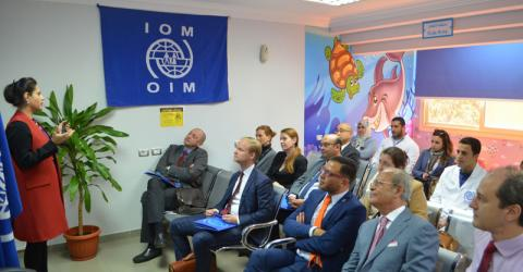 Dr. Asma Nadeem, head of IOM Egypt's Migration Health Unit, briefs attendees about the migration health assessment centre (MHAC) and its role. Photo: IOM