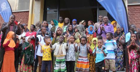 Delegates visit an IOM refugee transit center. Photo: IOM.