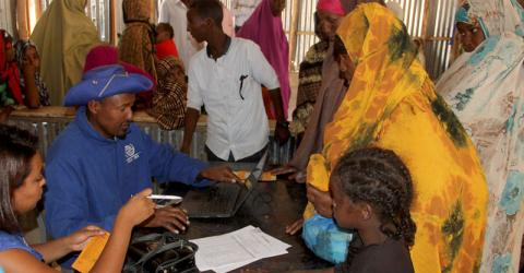 IOM staff helps Somali asylum seekers relocate from Sheder to Dollo Ado refugee camps in Ethiopia. © IOM 2016