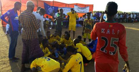 Young Somali refugees play against each other in a soccer tournament organized by IOM. Photo: IOM