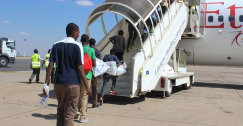 Ethiopian migrant teenagers fly home from Malawi. Photo: IOM