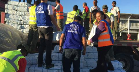 IOM and Government staff offloading the 80 tonnes of aid which arrived overnight in Fiji for communities affected by Cyclone Winston. ©IOM 2016