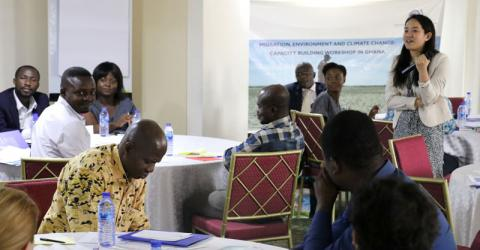 Participant discussions on the migration-environment nexus during the workshop. Photo: IOM