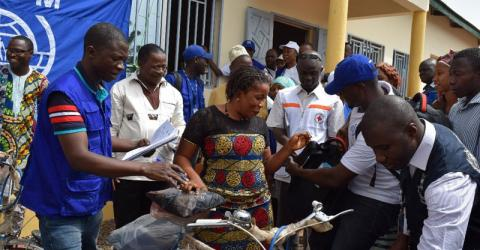 Distribution of bicycles and equipment to community health agents during the launching ceremony of the Community event-based surveillance activities in Boké. Photo: IOM/O. Diogo D 2016
